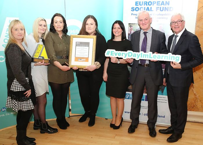 Members of the New Futures programme holding their STAR Award with funders