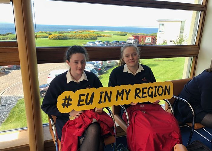 Two Transition Year students holding a sign saying #euinmyregion at the Marine Institute