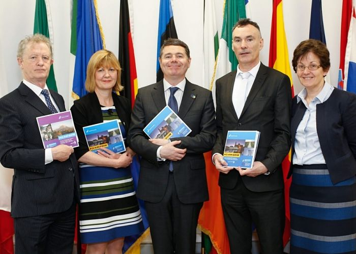 Minister Paschal Donohoe marks Europe Day with launch of EU in my Region Publications with Colleagues in front of EU Flags