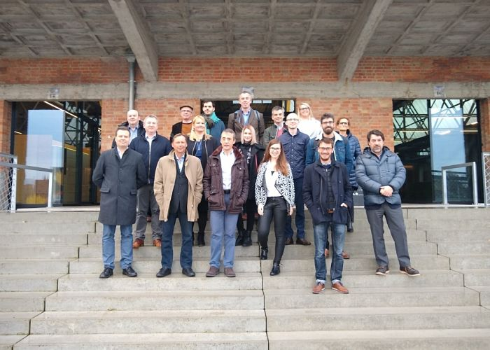 DEVISE Project Staff Exchange – West Flanders Group of participants gathered on steps in front of a building
