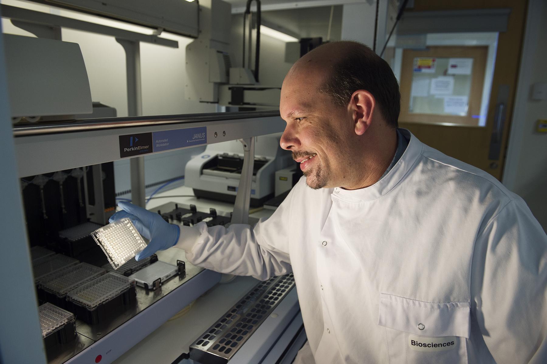 NUIG-Curam- Scientist beside machine
