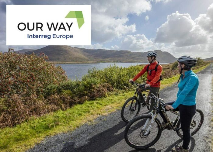 Image of two cyclists on the great-western-greenway-with-our-way-logo