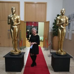 Svetlana Litvinskiene Standing between two Oscar statues