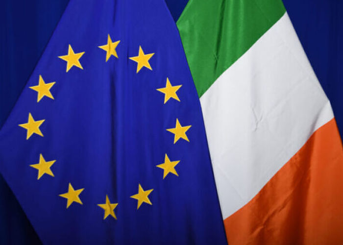 The national flag of Ireland next to the European flag