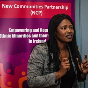 New Communities Partnership Backdrop and female staff member