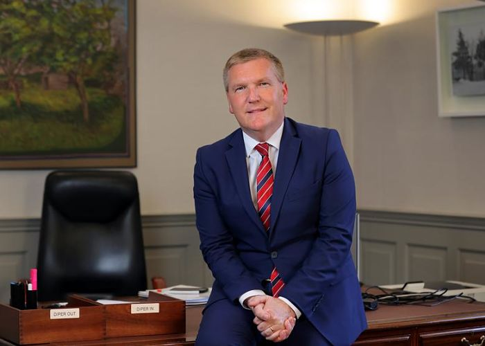 Public Expenditure and Reform Minister Michael McGrath sitting on his desk